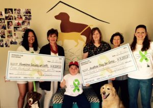 Presenting the Board Members of the Humane Society at Lakewood Ranch their check for the proceeds from Doggies For Duchenne